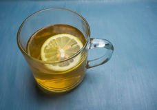 Soothing hot lemon tea. Hot tea with lemon to soothe a sore throat or cough Stock Photos