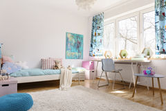 Soothing power of pastel colors. Teenager room with a space for relax and learn. The room has a big window Stock Image