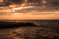 Soothing Sunset With Majestic Clouds. A beautiful and peaceful soothing sunset with majestic clouds and wavy sea during a windy day. Photo taken in Marmara Stock Photo