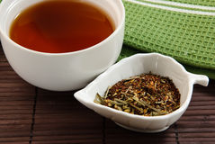 Soothing tea on bamboo mat Royalty Free Stock Photos