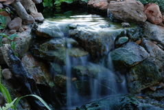 Soothing Waterfall. Small backyard waterfall in the evening Royalty Free Stock Images