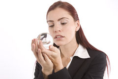 Soothsayer. Woman in business suit holding a crystal ball in her hands Royalty Free Stock Photography