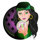 Soothsayer. Brunette fortune teller holding a sparkling crystal ball in hand Royalty Free Stock Photography
