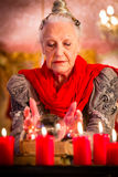 Soothsayer during esoteric session with Crystal ball Royalty Free Stock Photography