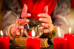 Soothsayer during esoteric session with Crystal ball Stock Image