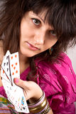 Soothsayer with scrying cards. Closeup portrait of soothsayer with scrying cards Stock Images