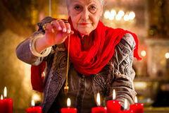Soothsayer during a Seance or session with pendulum Stock Images