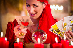 Soothsayer in Seance or session with tarot cards. Fortuneteller with Tarot cards or esoteric Oracle, sees in the future Royalty Free Stock Image