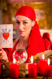 Soothsayer in Seance or session with tarot cards. Fortuneteller with Tarot cards or esoteric Oracle, sees in the future Royalty Free Stock Photography