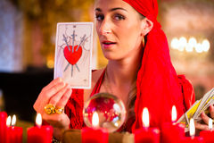 Soothsayer in Seance or session with tarot cards. Fortuneteller with Tarot cards or esoteric Oracle, sees in the future Stock Images