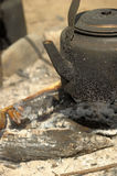 Sooty kettle in the tourism campaign. Naked coals and ashes bonfire Royalty Free Stock Photos