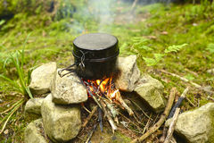 Sooty pot. Hiking in the Ukrainian Carpathians. Little sooty pot over a campfire Stock Photos