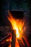 Sooty pot tourist hanging over the fire. Sooty pot hanging over the fire Royalty Free Stock Photography