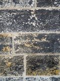 Sooty stone wall detail Royalty Free Stock Image