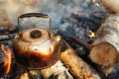 Sooty teapot on camping bonfire. Making tea and coffee Royalty Free Stock Photos