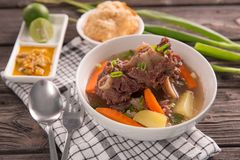 Sop buntut or oxtail soup. Indonesian traditional culinary royalty free stock photo