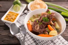 Sop buntut or oxtail soup. Indonesian traditional culinary stock photos