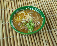 Sop saudara. Beef or buffalo soup specialty of Makassar city, South Sulawesi Royalty Free Stock Photo