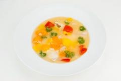 Sopa amarilla de los pescados Fotos de archivo libres de regalías
