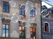 Sopa bubbles floating over old town houses.  Royalty Free Stock Photo