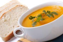 Sopa da abóbora com pão no branco Foto de Stock Royalty Free