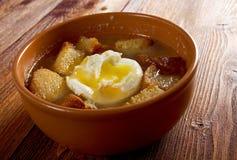 Sopa de ajo. Castilian garlic soup.farm-style Royalty Free Stock Image