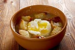 Sopa de ajo. Castilian garlic soup.farm-style Stock Photography