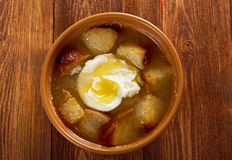 Sopa de ajo. Castilian garlic soup.farm-style Royalty Free Stock Images