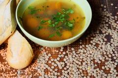 Sopa de lentilha com baguette Imagens de Stock Royalty Free