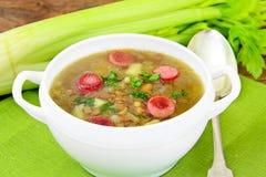Sopa de lentilha com salsicha fumado e aipo Foto de Stock Royalty Free