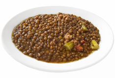 Sopa de lentilha no prato branco. Fotos de Stock Royalty Free