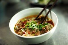 A sopa de macarronete vietnamiana da carne chamou o pho Imagens de Stock