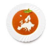 Sopa del tomate de la placa con crema en la forma de Europ Imagen de archivo libre de regalías