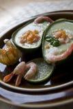 Sopa do abacate com salsa do physalis-camarão fotografia de stock royalty free