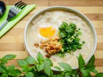 Sopa do arroz com carne, ovo e ervas Imagem de Stock Royalty Free