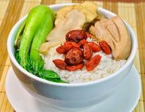 Sopa do arroz da erva da galinha com vegetal Imagem de Stock Royalty Free