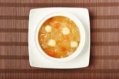 Sopa doce das sementes do fungo branco e dos lótus fotos de stock royalty free