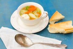 Sopa dos peixes com colher de prata Imagem de Stock Royalty Free