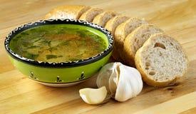 Sopa, pan y ajo Foto de archivo libre de regalías