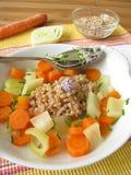 Sopa vegetal com soletrado imagem de stock