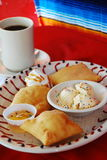 Sopalpilla and ice cream. Dessert made with fried flour tortilla with cinnamon, sugar served with ice cream honey and hot coffee royalty free stock photos