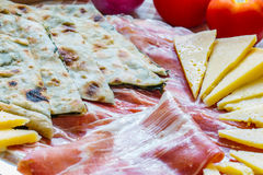 Soparnik with prosciutto and cheese. Croatian typical traditional food, soparnik and prosciutto and cheese Stock Images