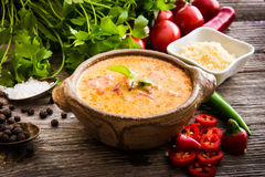 Sope queso with vegetables on wooden background Stock Photography