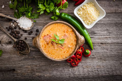 Sope queso with vegetables on wooden background. Sope queso with vegetables and spices on a wooden background stock photography