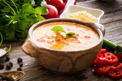 Sope queso with vegetables on wooden background. Sope queso with vegetables and spices on a wooden background royalty free stock photography