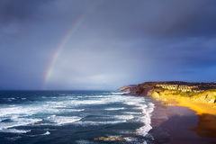 Sopelana beach with stormy clouds and rainbow. Sopelana beach with stormy clouds and a rainbow Royalty Free Stock Photos