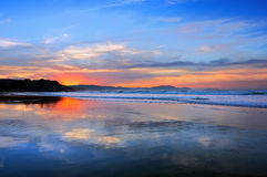Sopelana beach at sunset. With cloud reflections royalty free stock photography