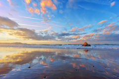 Sopelana beach at sunset with couds reflections. On shore royalty free stock images