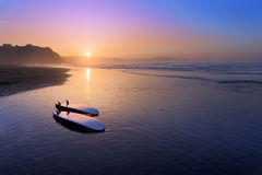 Sopelana beach with surfboards on the shore. At sunset stock photos