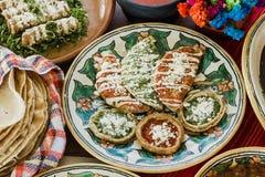 Sopes, tacos dorados and flautas de pollo, Mexican food, spicy sauce in Mexico stock images